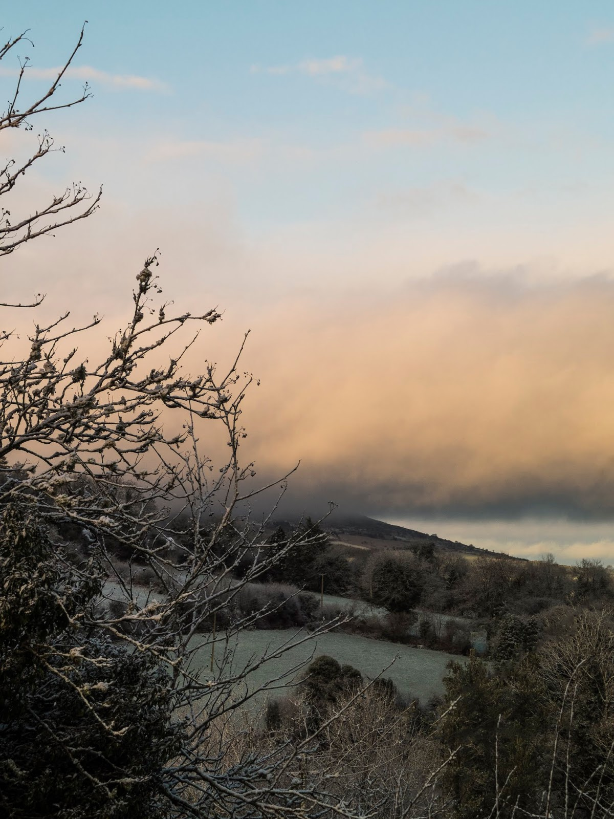 Sunset cloud over the top of a snow covered mountain in North Cork.