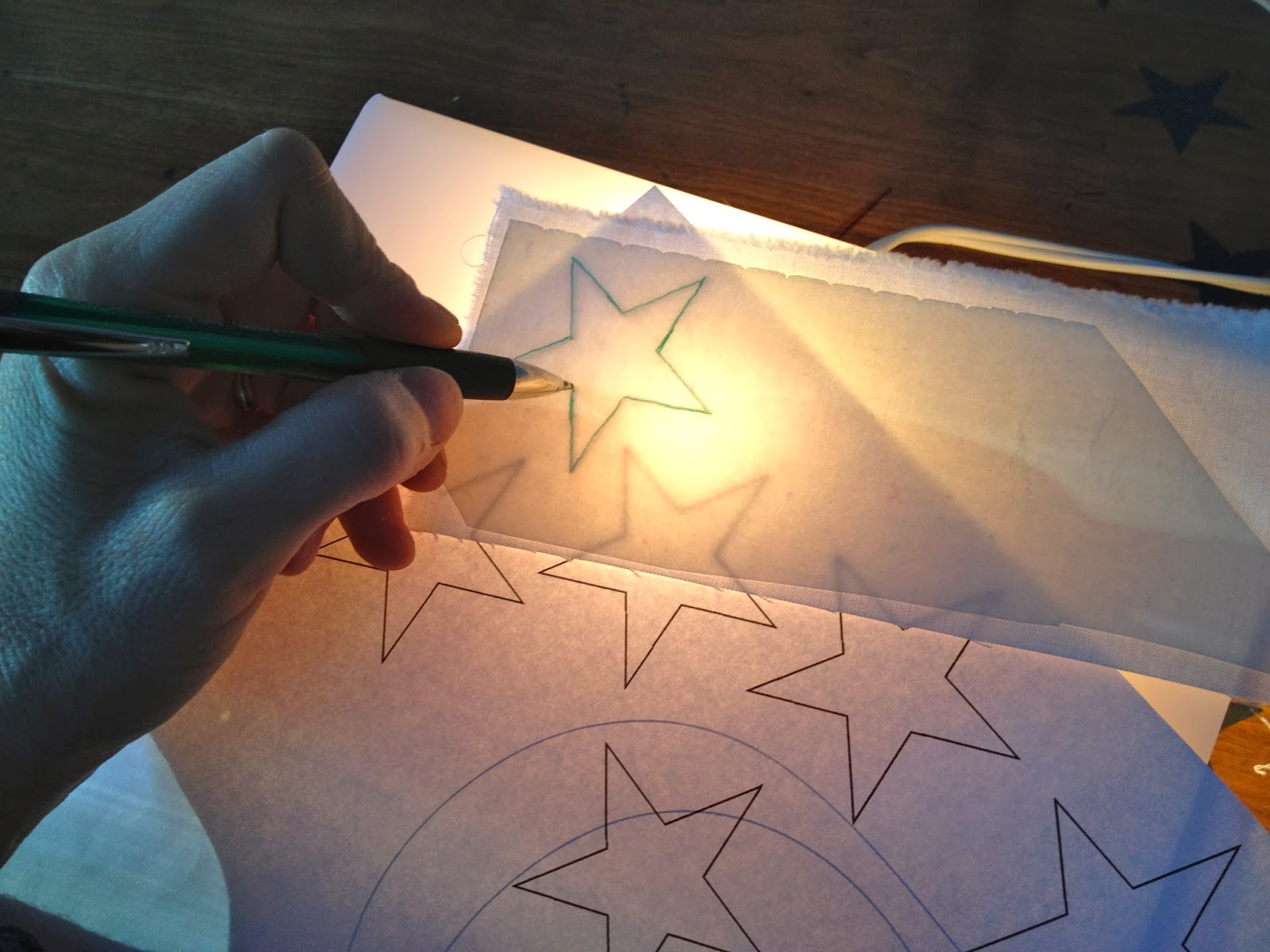 trace stars onto white fabric