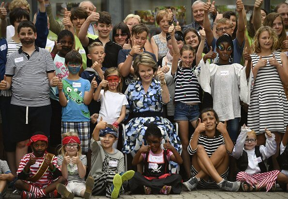 Queen Mathilde visits Playground Space summer camp in Zoutleeuw. The Queen wore Natan blue print midi shift dress