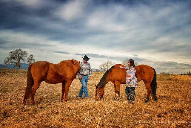 engagement photo with couple and two horses in colorado