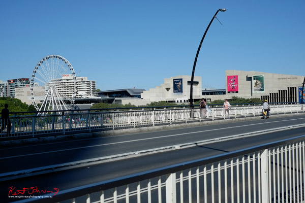 Ferris wheel and QPAC, South Bank Brisbane from Victoria Bridge. Photo by Kent Johnson.