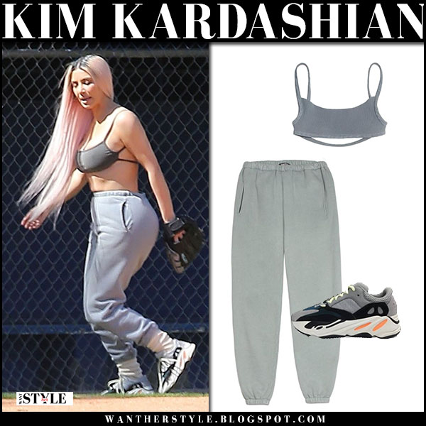 Kim Kardashian in grey bra, grey sweatpants and grey sneakers yeezy adidas casual style march 7