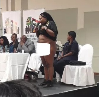 Rape victim strips naked in public to show South Africa president scar inflicted by rapists
