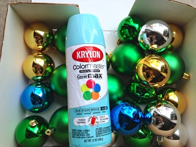 spray painting Christmas ornaments