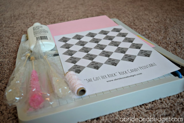"Want a tasty (and easy) bridal shower or engagement party favor? Make our DIY ""She Got Her Rock"" Rock Candy Favor from www.abrideonabudget.com. Even better, there's a free printable for the tags in the post too!"