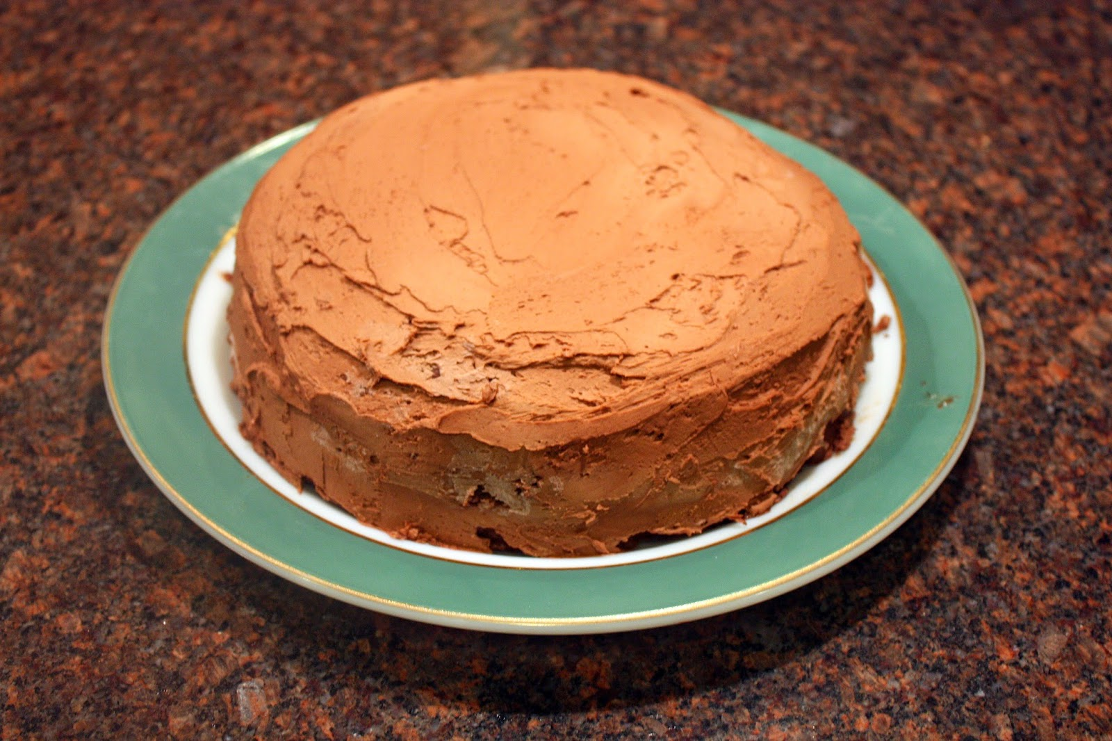 vegan sweet potato layer cake with candied pecans and chocolate frosting