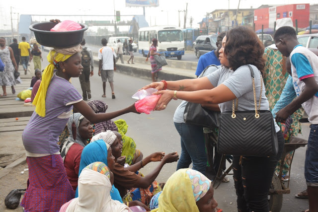 nollywood actress marks birthday with lagos street beggars