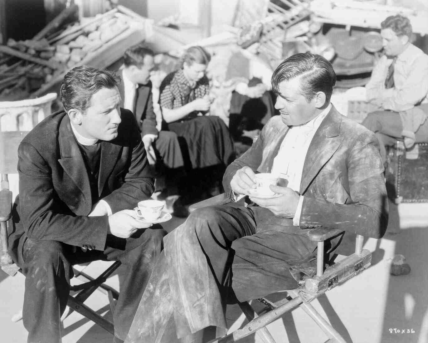 spencer tracy and clark gable on a break from filming the earthquake sequence