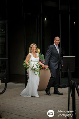 the bride and groom walk to the alter for their wedding in boulder colorado