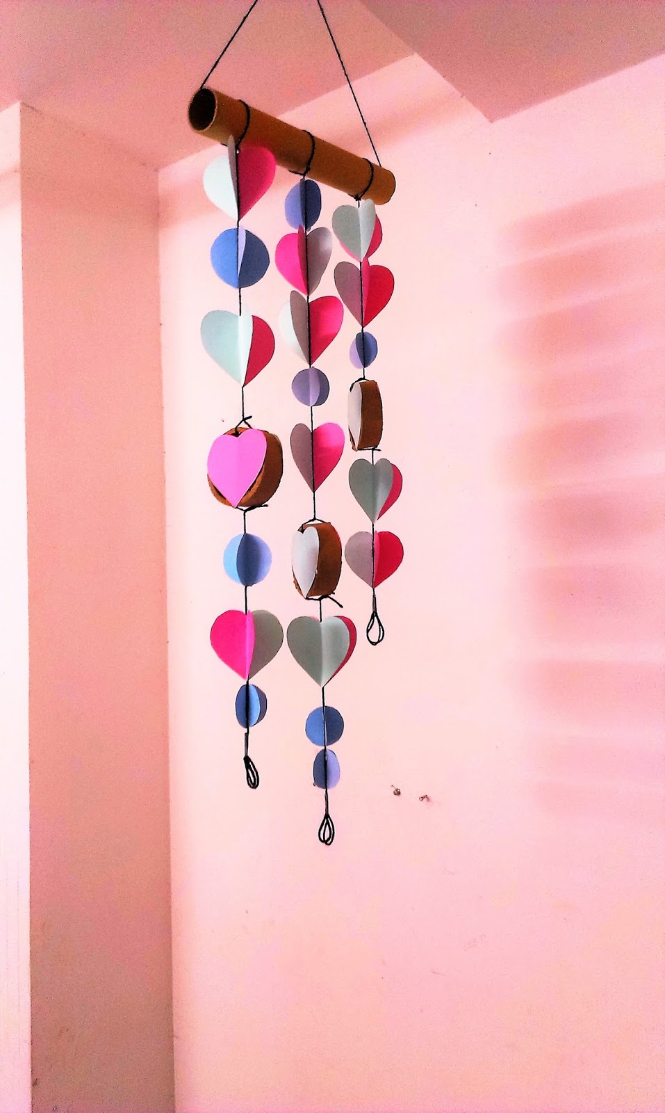 Take  long tissue paper roll colorful chart and string to create this wall hanging also diy room decor best out of waste rh auntmadespot