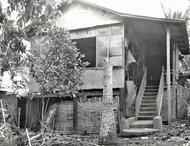An eerily deserted house of victims of Japanese brutality in Lipa, Batangas in 1945.  Image source:  United States National Archive.