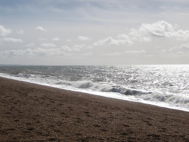 Waves breaking against Chesil Beach. Looking east from Burton Bradstock. Dorset