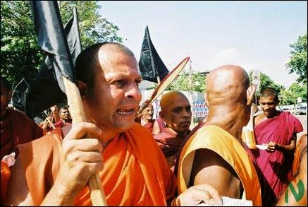Buddhist monks with weapons