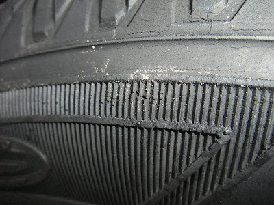 cracked, cut, tire sidewall, popped tire, hole