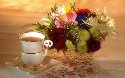 lovely-morning-with-tea-and-colorfull-flowers