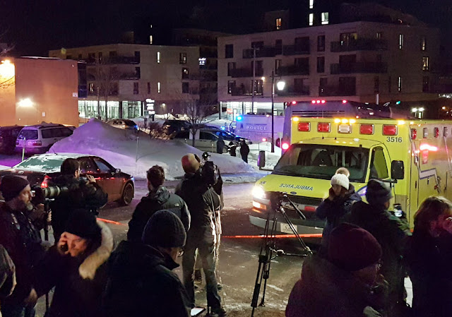 Image Attribute: An ambulance is parked at the scene of a fatal shooting at the Quebec Islamic Cultural Centre in Quebec City, Canada January 29, 2017. REUTERS/Mathieu Belanger