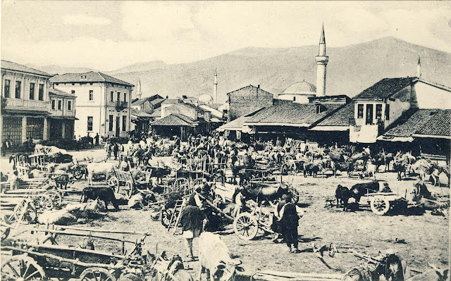 Wood Market on photo postcard from 1916 with a view to the southwest. This is one of the most common items of German postcards and photographs. Photographed from all angles usually on market day when its full with sellers from surrounding villages with their carts. In the background is seen Baba Mountain and some of the mosques.
