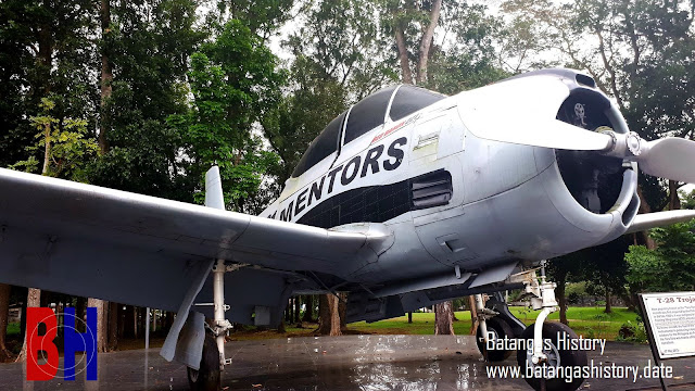 A T-28 Trojan aircraft at the gate of Fernando Air Base.