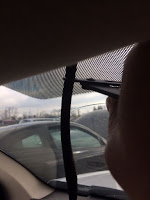 Cut the cable attached to the mirror as close to the headliner as possible