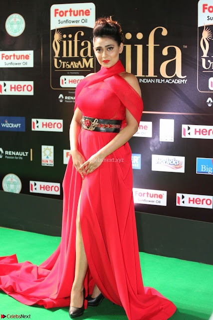Apoorva in a Stunning Tight Leg Split Sleeveless Red Gown at IIFA Utsavam Awards 001.JPG