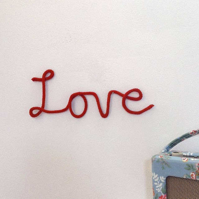 Knitted 'love' sign