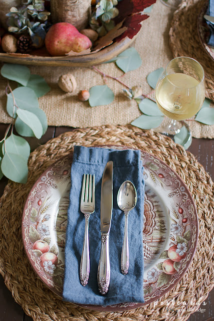 vintage silver on blue napkin in fall table setting