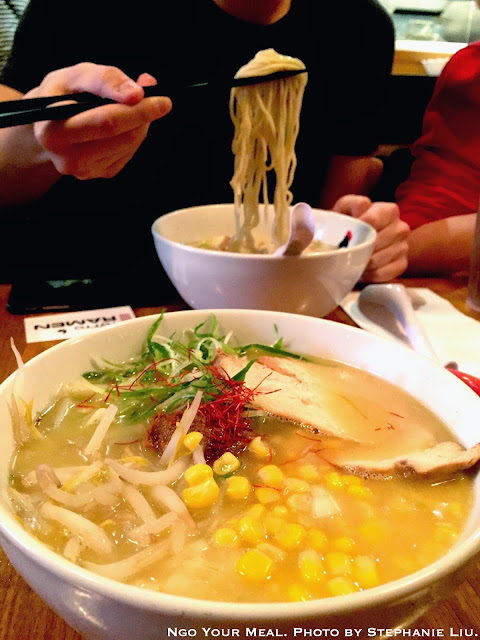 Totto Extra Spicy Miso Ramen: The finest Koji Miso and ground pork in a scoop atop slightly wavy noodles in original Paitan soup. Topped with a seasoned halfboiled egg, scallion, bean sprouts and onion at Totto Ramen.