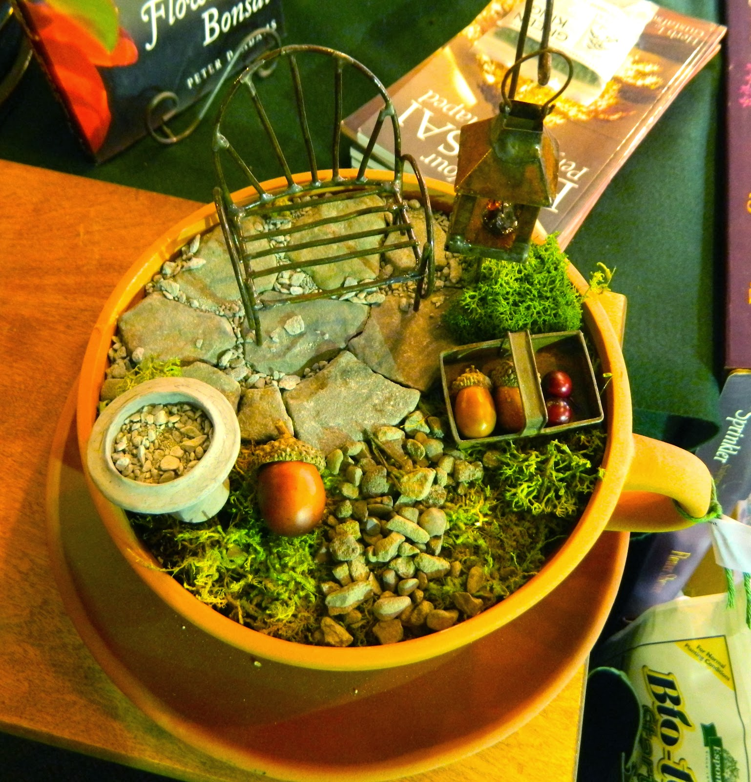 Every sort of accessory was displayed on a large table in the garden shop   arbors  garden chairs  planters  bird houses  garden tools. Pam s English Cottage Garden  Miniature Gardening  Part 1