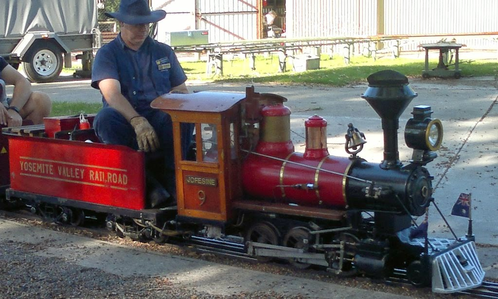"Model American style steam locomotive named ""Yosemite Valley Railroad Jofesine No. 9"" with its engineer."