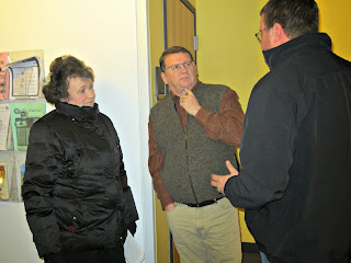 UATP staff talks to Rod Price (center) from the School of the Deaf and Blind.