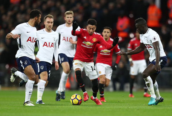Jesse Lingard of Manchester United attempts to get past Davinson Sanchez of Tottenham Hotspur during the Premier League match between Tottenham Hotspur and Manchester United at Wembley Stadium on January 31, 2018 in London, England.
