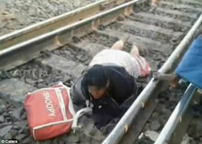 A woman miraculously survived being run over by a 42-carriage goods train in India