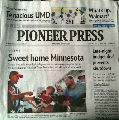 Front page of Pioneer Press with photo of young boy reaching toward baseball player
