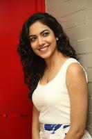 Actress Ritu Varma Stills in White Floral Short Dress at Kesava Movie Success Meet .COM 0108.JPG