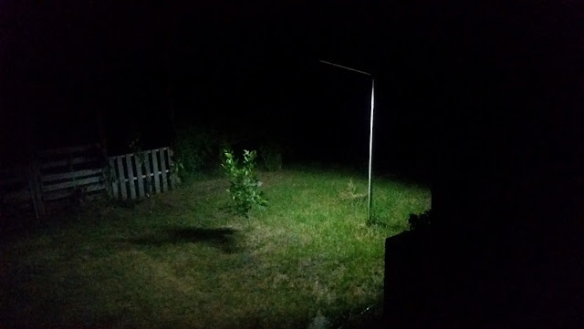 backyard lit up by solar light