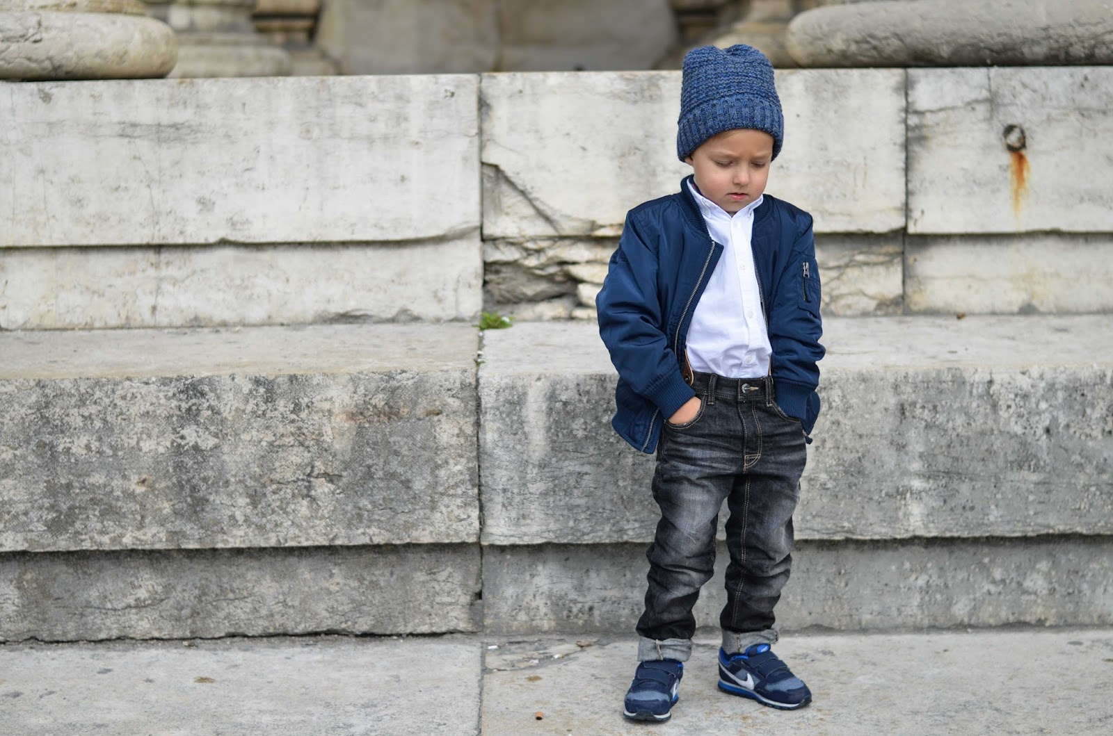 boy toddler style bomber jacket beanie sneakers jeans