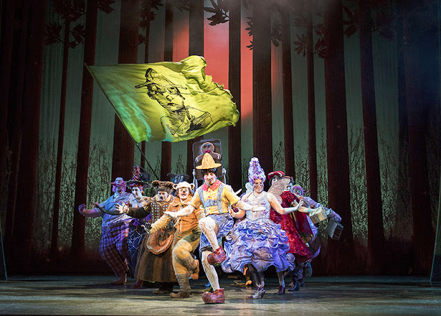 Fairytale characters from Shrek the Musical dancing together on stage.