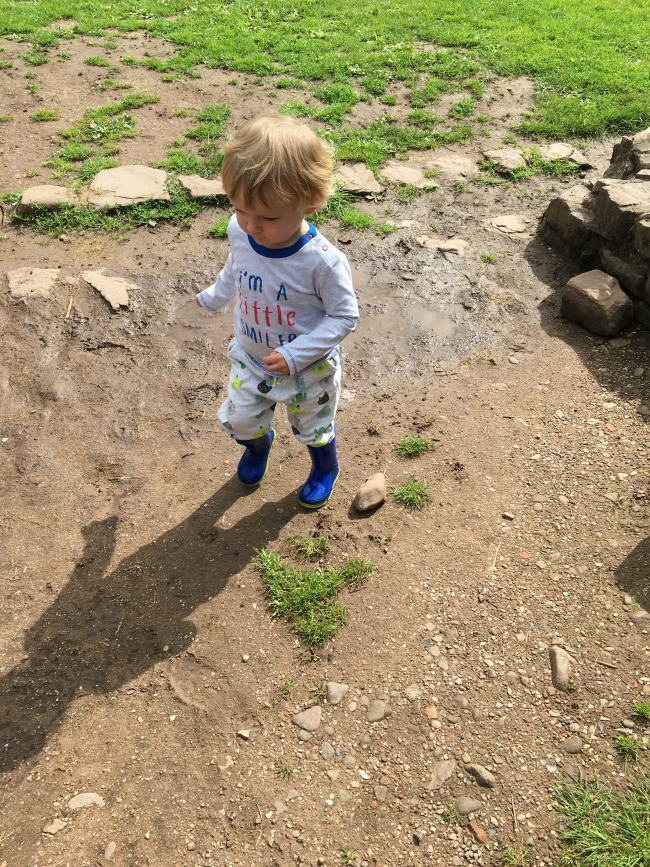 Caerleon-the-roman-fortress-of-isca-a-toddler-in-puddle