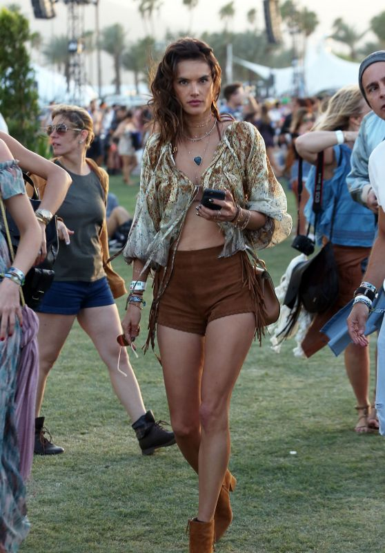 Alessandra Ambrosio in suede shorts and boho top at Coachella 2016