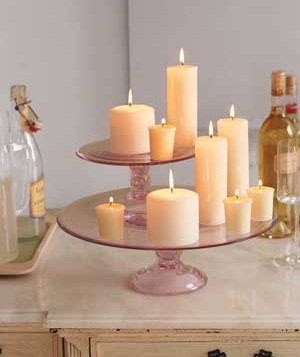 These candles resting on a cake tray make for a whimsical table centerpiece.