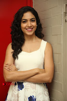 Actress Ritu Varma Stills in White Floral Short Dress at Kesava Movie Success Meet .COM 0091.JPG