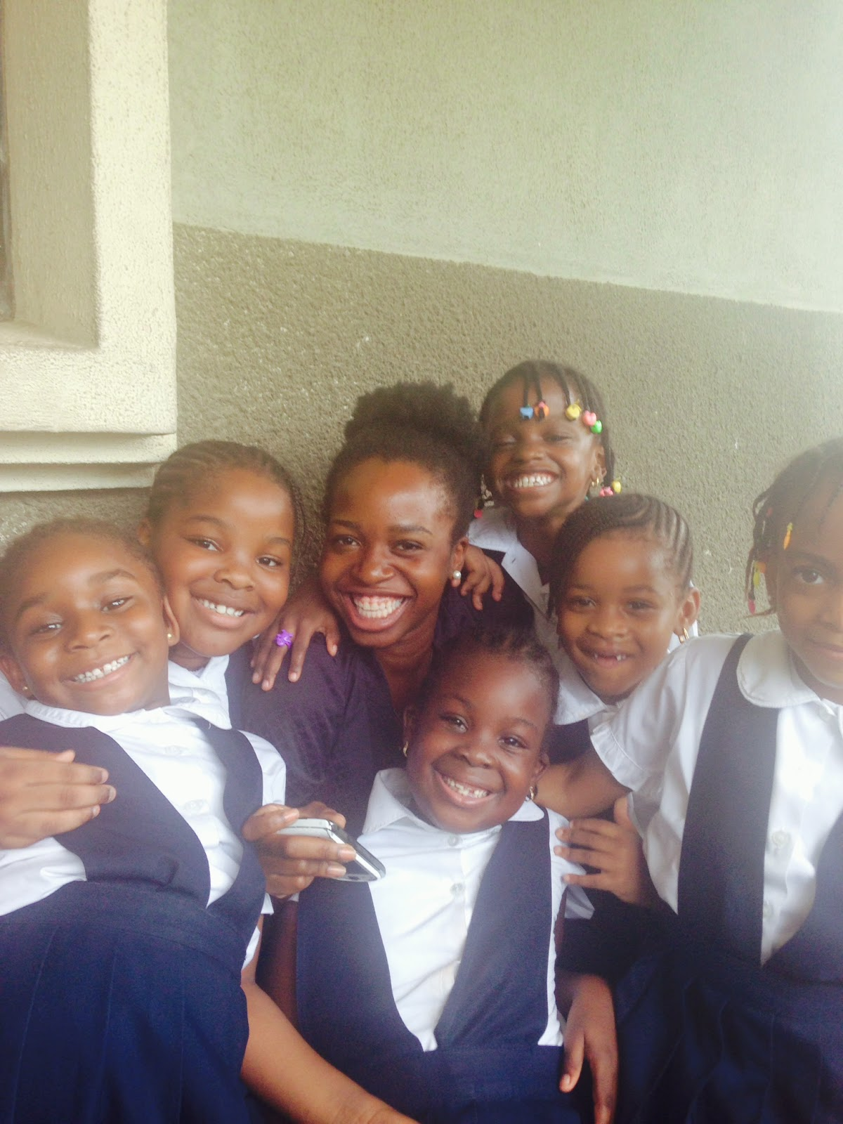African Teacher with Students Happy