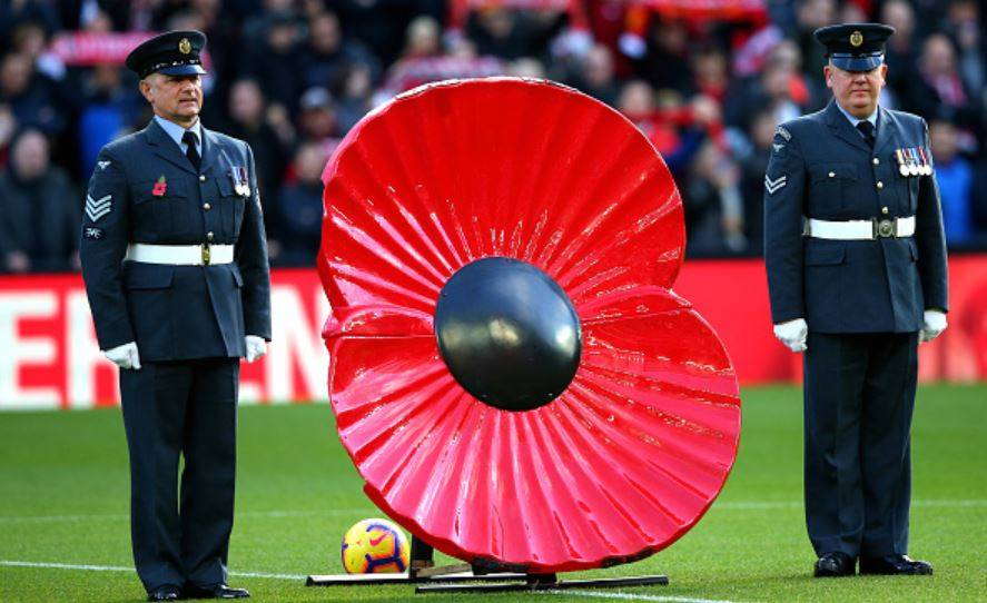 Poppy-statue-and-soldiers-on-pitch-at-Anfield