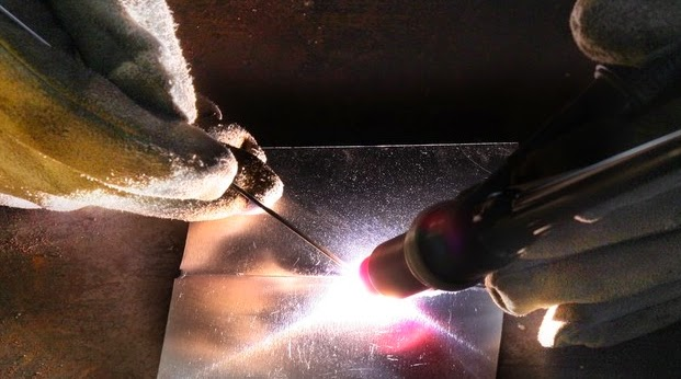What causes Weld Tungsten Inclusion