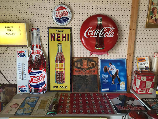 Vintage Signs are popular at the 301 Endless Yard Sale