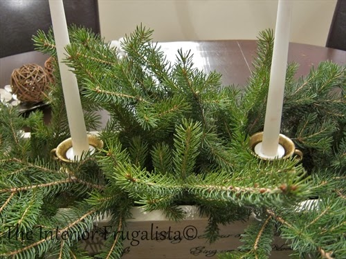 Tea cup ornaments being held in place with food cans in pallet board centerpiece