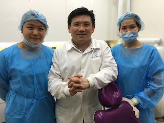 B9 dental ; Dr Raymond Lim with his friendly staff