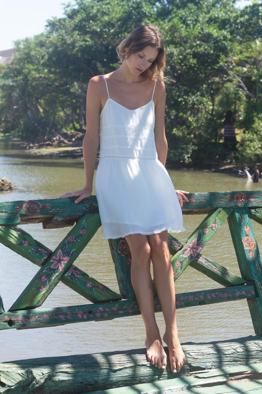 Fashion blogger and designer, Alison Hutchinson, is wearing a KAYVALYA Maya Dress in white