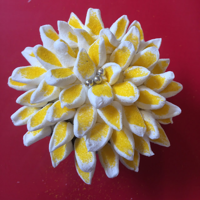 yellow and white flower cupcake