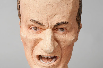 sculpture of man with angry face